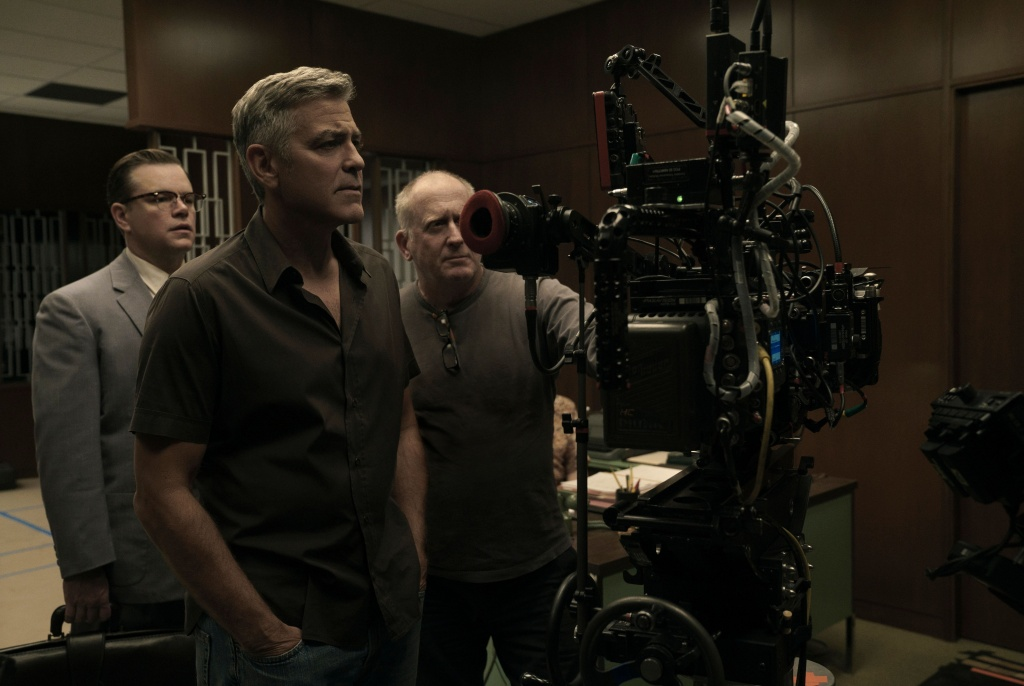 Matt Damon, Director George Clooney and Cinematographer Robert Elswit on the set of SUBURBICON, from Paramount Pictures and Black Bear Pictures.
